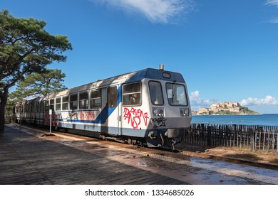 CALVI, CORSICA / FRANCE - OCTOBER 30, 2018: Passenger train of the local railway running along the sea