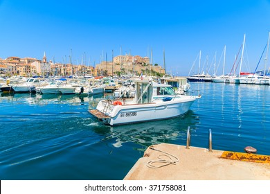 CALVI, CORSICA ISLAND - JUN 28, 2015: tourist boat departing Calvi port. This town has beautiful marina and is very popular tourist destination.