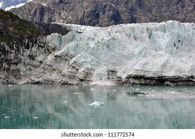 calving glacier in alaskan glacier bay national park in alaska