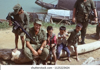 Cam Hieu, Quang Tri Province / Vietnam - Aug. 30, 1967: A U S Marine allowing village children to play with rifles and a bayonet in Cam Hieu village, Quang Tri Province, Vietnam, on Aug. 30, 1967.
