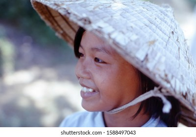 Cam Hieu, Quang Tri Province / Vietnam - October 11, 1967: A young Vietnamese girl wearing the traditional conical hat photographed in Cam Hieu Village in the former South Vietnam.
