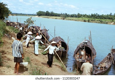 Cam Lo, Quang Tri Province / Vietnam: July 20, 1967: Vietnamese boat people and women in tradition dress taking wares to market along the Cam Lo River in Cam Lo, Vietnam, on July 20, 1967.