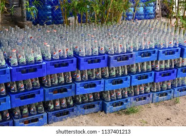 Cam Ranh. Vietnam. July 10, 2018. Empty glass bottles of Pepsi, Mirinda in Pepsi container.