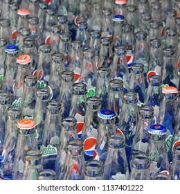 Cam Ranh. Vietnam. July 10, 2018. Empty glass bottles of Pepsi and Mirinda soft drink. Glass bottles in plastic box.