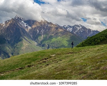 CAMAGGIORE, ITALY - APRIL 30th 2018: Mountaineer walking on a mountain meadow above the Camaggiore village in the spring.
