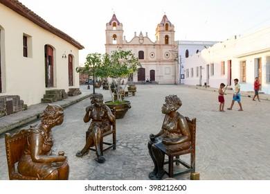 Camaguey, Cuba - 11 January 2016: Statues of artist Martha Jimenez in front of the Carmen church at Camaguey on Cuba