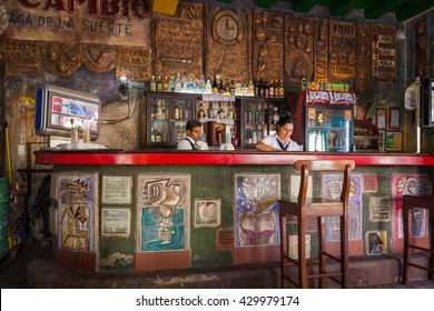 CAMAGUEY, CUBA - CIRCA AUGUST 2015: Interior of El Cambio, Camaguey, Cuba. The bar opened in 1909 with the name of Casa de la Suerte (or House of Luck) and is a famous hangout.