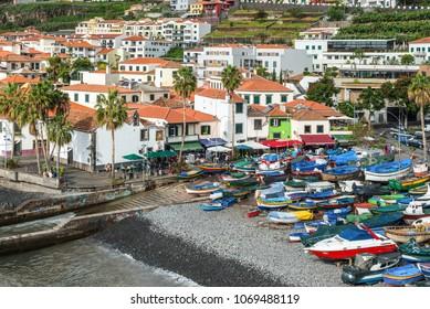 Camara de Lobos, Madeira, Portugal - December 10, 2016: Street view of the fishing village Camara de Lobos near Funchal, Madeira Island, Portugal. Colorful fishing boats on the shore.