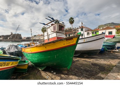 Camara de Lobos, Madeira, Portugal - December 10, 2016: Fishing boats drawn up on beach and slipway at Camara de Lobos in Madeira Island, Portugal.