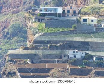 Camara de Lobos, Portugal / Portugal - January 2019: Modern building on a cliff in Camara de Lobos