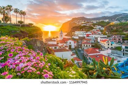 Camara de Lobos village at sunset, Cabo Girao in background, Madeira island, Portugal