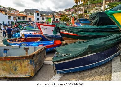 Camara de Lobos/Maderia - Portugal - 10/13/18 - Colorful boats in the harbor in Camara del Lobos during hurricane Leslie - Portigal