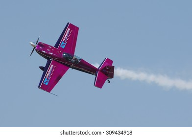 CAMARILLO AIRPORT, CA/USA - AUGUST 23 2015: Vicky Benzing in her Extra 300 shown performing at the Wings Over Camarillo airshow.