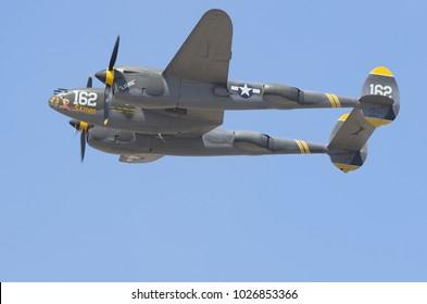 CAMARILLO, CA/USA - AUGUST 23, 2015: Lockheed P-38 Lightning 'Skidoo' shown during a flight demo. The P-38 is a World War II era American fighter aircraft.
