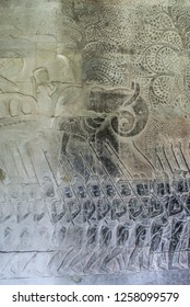 Cambodia, Angkor Wat, a fragment of a wall, a stone bas-relief, warriors going to war and a warlord riding an elephant