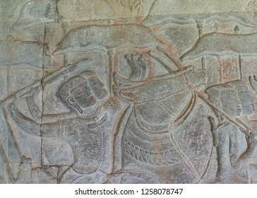 Cambodia, Angkor Wat temple, UNESCO heritage, stone bas-relief two horsemen close up