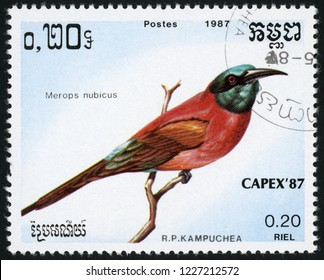 CAMBODIA - CIRCA 1987: stamp printed in Kampuchea shows merops nubicus (northern carmine bee-eater); birds; CAPEX 87; Scott 789 A160 0.20 riel; circa 1987