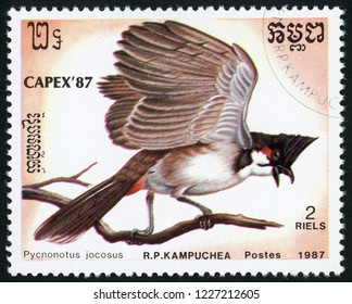 CAMBODIA - CIRCA 1987: stamp printed in Kampuchea shows pycnonotus jocosus (red-whiskered bulbul or crested bulbul); birds; CAPEX 87; Scott 794 A160 2riels; circa 1987