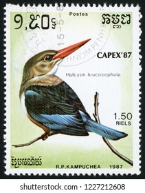 CAMBODIA - CIRCA 1987: stamp printed in Kampuchea shows halcyon leucocephala (grey-headed kingfisher); birds; CAPEX 87; Scott 793 A160 1.50 riels; circa 1987
