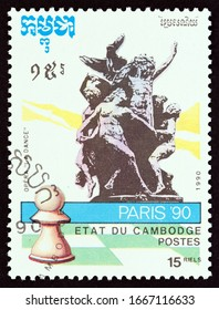 """CAMBODIA - CIRCA 1990: A stamp printed in Cambodia from the """"World Chess Championship Paris '90"""" issue shows La Danse on the façade of the Paris Opera by Jean-Baptiste Carpeaux, circa 1990."""
