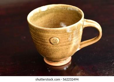 "Cambodia ""Kampong chhang"" pottery coffee cup"