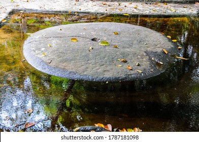 Cambodia: Kbal Spean; carvings on the banks of and in the bed of the river are said to sanctify the waters that feed Angkor. Here a circular carved stone is set within a square.