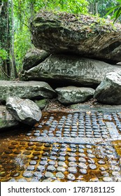 Cambodia: Kbal Spean; carvings on the banks of and in the bed of the river are said to sanctify the waters that feed Angkor.  Some of the thousand lingas carved into the riverbed.