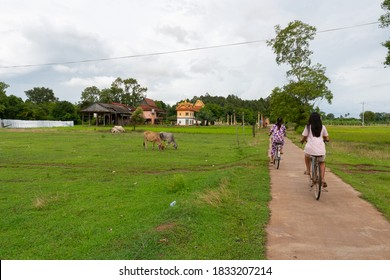 Cambodia, Koh Trong island, women on bikes