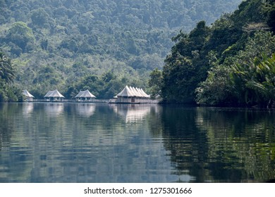 Cambodia, Ko-Hong - March 2016: 4 rivers tented jungle ecotourism hotel coming into view around a bend in the Kong River