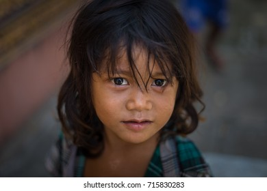 CAMBODIA - September 9,2017 : Poor girl looks on in Cambodia at battambang city ,CAMBIDIA
