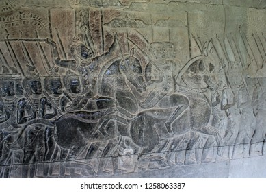 Cambodia, the temple of Angkor wat, stone bas-relief warriors go to war on foot, a warlord on a horse