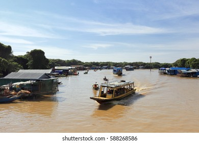 Cambodia, Thailand - December 19, 2014: Excursion boat trip on the river in Cambodia on a sunny day.