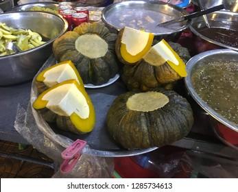 "CAMBODIA TRADITIONAL DESSERT, ""PUMPKIN PUDDING"".  Stuffed with coconut egg custard."