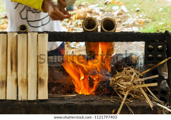 Cambodian food specialty (Kralan) - Bamboo sticks filled with sticky rice beans and grilled over open fire.