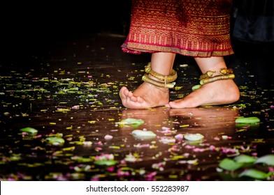 Cambodian girl feet dancing on the wooden floor