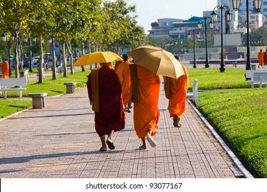 Cambodian monks walking on the street in Phnom Penh