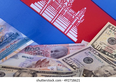 Cambodian riel and American dollars with Cambodian flag.