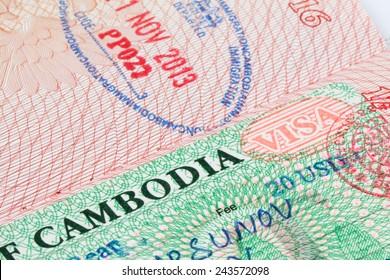 Cambodian visa stamp in foreign passport sheet