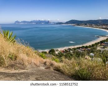 Camboinhas beach and Itaipu lagoon, topview, after pleasant walk, on trail, climbing the Morro das Andorinhas, Niteroi, Rio de Janeiro.