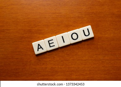 Cambre / Spain - April 18 2019: AEIOU vowel letters on a wood table