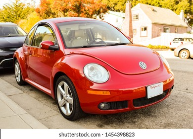 Cambria, California/United states - September 22, 2016:  New Shape Red Volkswagen Beetle car , parked in Cambria, California.