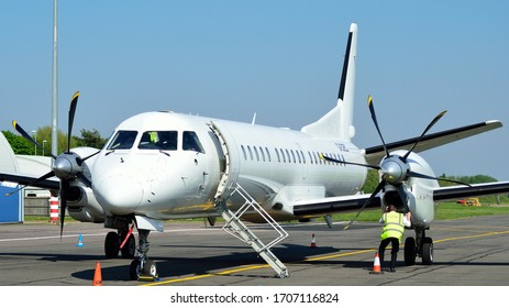 Cambridge Airport, Cambridgeshire/ United Kingdom - May 6 2018 : A white Saab 2000 passenger on the ramp at Cambridge Airport