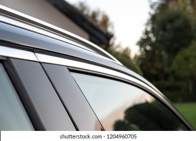 Cambridge, Cambridgeshire, UK - Circa October 2018: Detailed, shallow focus view of a Swedish-built SUV cars side door window and part of the metallic roof rack. Shown at a private residence.