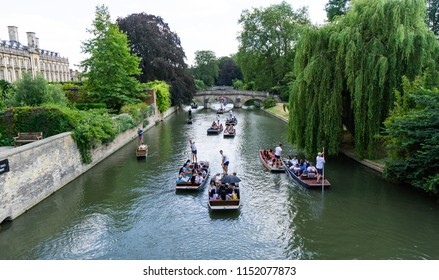 Cambridge, Cambridgeshire, United Kingdom - July 08, 2018: Tourists on punt trip (sightseeing with boat) along River Cam near Kings College in the city of Cambridge, United Kingdom