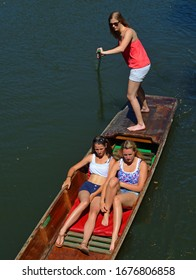 CAMBRIDGE, ENDLAND - JUNE 30, 2015: Young women  punting on the river Cam at Cambridge.