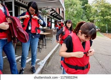Cambridge, England- 26 August 2017: Students wearing life jacket for their punting trip.