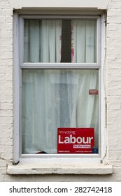 CAMBRIDGE, England - 7 MAY 2015: Poster Sign of UK Labour Party 'I'm Voting Labour' displayed in a window.