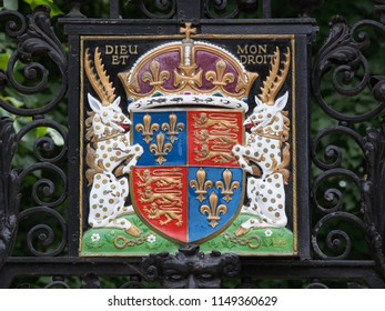 CAMBRIDGE, ENGLAND - AUGUST 2013:  Fences and gates at Cambridge University preserve the design of the royal coat of arms as it was hundreds of years ago.