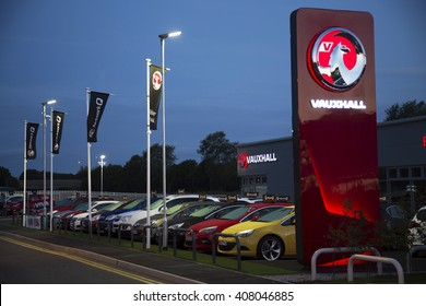 CAMBRIDGE, ENGLAND - AUGUST 22: Exterior of newly opened independent Vauxhall car dealership, at night, showing signage. In Cambridge, England. On 22nd August 2015.