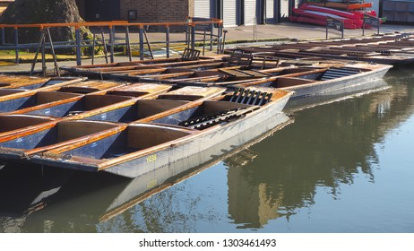 Cambridge, England. Group of empty wooden boats during the winter time used for tours around the Cambridge University colleges along the river Cam